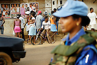 LIBERIA, Monrovia, 05/04/2007..A crowd of people gather outside a video parlour as Sheeba walks the street on Joint Task Force patrol. The unit provides essential armed back up to the fledging Liberian National Police force...© 2007 Aubrey Wade. All rights reserved.