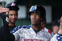 Micker Adolfo (27) of the Kannapolis Intimidators high fives a teammate after scoring a run against the Delmarva Shorebirds at Kannapolis Intimidators Stadium on June 30, 2017 in Kannapolis, North Carolina.  The Shorebirds defeated the Intimidators 6-4.  (Brian Westerholt/Four Seam Images)
