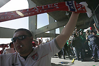 A United States fan holds a USA scarf above his head  while being jeered at by Mexican fans as they leave Azteca Stadium after the game. The United States Men's National Team played Mexico in a CONCACAF World Cup Qualifier match at Azteca Stadium in, Mexico City, Mexico on Wednesday, August 12, 2009.  Mexico won 2-1.