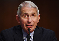 Dr. Anthony Fauci, director of the National Institute for Allergy and Infectious Diseases, testifies before the Senate Health, Education, Labor and Pensions (HELP) Committee, during a hearing on Capitol Hill in Washington DC on Tuesday, June 30, 2020. Fauci and other government health officials updated the Senate on how to safely get back to school and the workplace during the COVID-19 pandemic. Credit: Kevin Dietsch/CNP/AdMedia