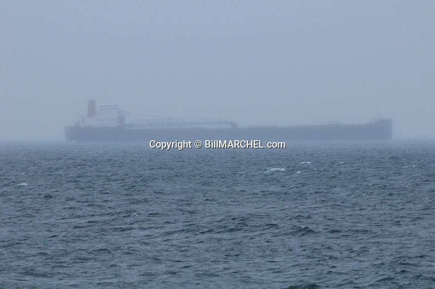 00704-001.03 Lake Superior: Oar ship on the lake during foggy and rainy weather.