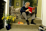 Des Lynam, British sport journalist, learning Spanish at home. 1980S
