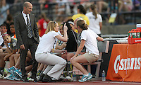 Philadelphia Independence head coach, Paul Riley, looks on as team physician, Dr. Anne Colton, checks midfielder, Caroline Seger (9) for concussion symptoms.  Seger would retun to action in Philly's 1-0 win over the Atlanta Beat.