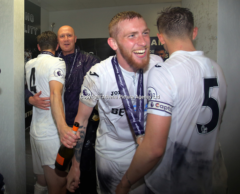 Pictured: John Toshack gets drenched in champagne by Oliver McBurnie of Swansea City Monday 15 May 2017<br /> Re: Premier League Cup Final, Swansea City FC U23 v Reading U23 at the Liberty Stadium, Wales, UK