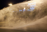 Police use a water cannon to disperse protesters in Besiktas, near the office of the prime minister, in Istanbul, Turkey, June 4, 2013. What started as a peaceful sit-in to save a small park near Taksim Square from being turned into a shopping mall has turned into large-scale anti-government demonstrations in cities across Turkey. In Istanbul, the protests have united communists, nationalists, anarchists, social liberals, and others unhappy with Prime Minister Recep Tayyip Erdogan's policies.