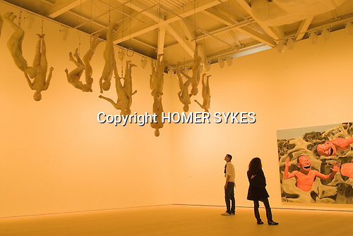 The Saatchi Gallery. The Duke of York Headquarters, Chelsea, London UK 2008. The Revolution Continues: New Art from China. Chinese Offspring by Zhang Dali  and Backyard Garden ( painting ) by Yue Minjun.