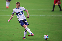 ORLANDO, FL - APRIL 24: Andy Rose #15 of Vancouver Whitecaps kicks the ball during a game between Vancouver Whitecaps and Toronto FC at Exploria Stadium on April 24, 2021 in Orlando, Florida.