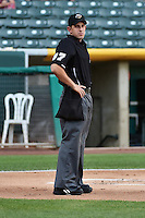 Umpire Adam Schwarz handles the calls behind the plate during the Pacific Coast League game between the Salt Lake Bees and the Reno Aces at Smith's Ballpark on July 23, 2014 in Salt Lake City, Utah.  (Stephen Smith/Four Seam Images)