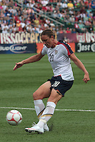 USWNT'S Abby Wambach (20) takes a shot. The U.S. Women's National Team defeated Canada 1-0 in a friendly match at Marina Auto Stadium in Rochester, NY on July 19, 2009. Abby Wambach of the USWNT scored her 100th career goal in the second half..