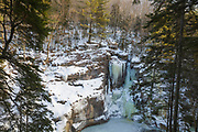 """Icicles on the cliffs of the area known as """"The Pool"""" in Franconia Notch State Park of New Hampshire USA. The Pool is a deep basin in the Pemigewasset River located next to the Sentinel Pine Covered Bridge."""