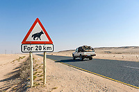 """Traffic sign, """"Caution! Hyenas"""", southern Namibia, Africa"""