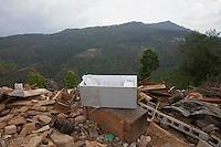 Damaged belongings lay on the ground at Jalkeni village, Karvrepalanchowk, outside of Kathmandu, Nepal. May 1, 2015