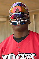 Carolina's Frank Moore (35) sports 6 pairs of sunglasses at Five County Stadium in Zebulon, NC, Sunday, July 2, 2006.  The Mudcats defeated the Smokies 4-0.