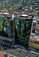 aerial photograph of the MetLife  tower, Mexico City, with the Periferico freeway in the foreground