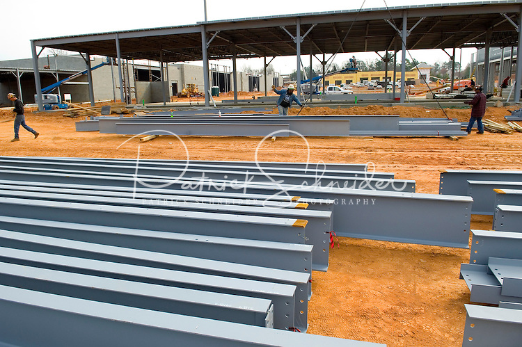 02/22/07:  Rows of steel support beams sit ready to be transformed into a new structure during expansion/construction of a Charlotte-area shopping center. Charlotte, NC, is one of the country's fastest-growing cities. ..By Patrick Schneider- Patrick Schneider Photography.