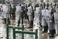 BOGOTA, COLOMBIA - APRIL 28 : Polices stand guard during a national strike Against the Duque package and the tax reform on April 28, 2021 in Bogota, Colombia. Colombia has the minimum wage around $ 250 per month where people are unhappy about corruption, unemployment, and inequality by Government. (Photo by Leonardo Munoz/VIEWpress)