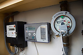 Water, electricity and energy consumption meters in the kichen of a maisonette at the Beddington Zero Energy Development (BedZED) in the London Borough of Sutton.  BedZED, the UK's largest carbon-neutral eco-community, comprises 82 mixed tenure housing units, managed by the Peabody Trust, and north-facing offices.