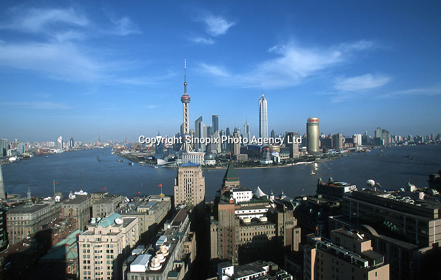 View of Shanghai's Pudong District and the Huangpu River. Shanghai stands as the world's remaining few economic bright spots, and has seen rapid growth in the past decade..20-FEB-03