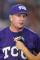 TCU Horned Frogs Head Coach Jim Schlossnagel (22) is interviewed during Game 12 of the NCAA College World Series against the Vanderbilt Commodores on June 19, 2015 at TD Ameritrade Park in Omaha, Nebraska. The Commodores defeated TCU 7-1. (Andrew Woolley/Four Seam Images)