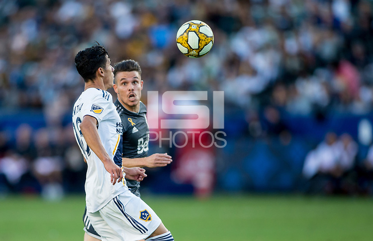 CARSON, CA - SEPTEMBER 29: Uriel Antuna #18 of the Los Angeles Galaxy scores a goal during a game between Vancouver Whitecaps and Los Angeles Galaxy at Dignity Health Sports Park on September 29, 2019 in Carson, California.