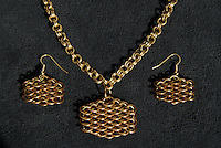 """A completed maille earring and necklace set that Michelle has titled """"Honeyscale"""", as it makes her think of honey and bees.  The necklace is a simple double cable (4-in-2) weave made out of 19 gauge 5/32"""" ID brass.  The earrings and pendant are both dragonscale weave made out of 18 gauge 1/4"""" ID bronze and 19 gauge 5/32"""" ID brass."""