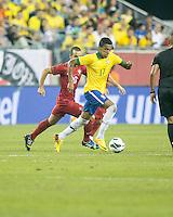 Brazil midfielder Luiz Gustavo (17) dribbles the ball with Portugal midfielder Ruben Amoriml (20) in pursuit.  In an International friendly match Brazil defeated Portugal, 3-1, at Gillette Stadium on Sep 10, 2013.