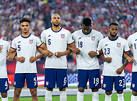 NASHVILLE, TN - SEPTEMBER 5: Antonee Robinson #5, John Brooks #6 and Jordan Pefok #19 of the United States stand on the field during a game between Canada and USMNT at Nissan Stadium on September 5, 2021 in Nashville, Tennessee.