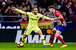 Arthur Melo of FC Barcelona (L) in action against Saul Niguez of Atletico de Madrid (R) during the La Liga 2018-19 match between Atletico Madrid and FC Barcelona at Wanda Metropolitano on November 24 2018 in Madrid, Spain. Photo by Diego Souto / Power Sport Images