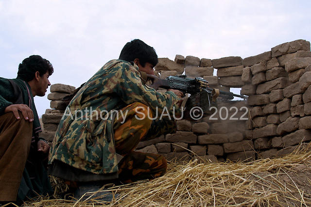 Northern Afghanistan <br /> October 2001<br /> <br /> Northern Alliance exchange fire at close range positions with the Taliban. A few minutes later American bombers hit the Taliban lines.