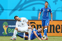 Luis Suarez of Uruguay screams as he is tackled by Giorgio Chiellini of Italy