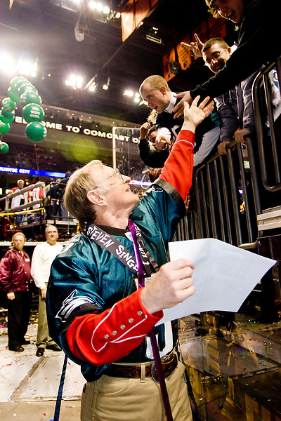 """Professional eater Rich LeFevre aka """"The Locust"""" takes in some adulation at the 14th annual Wing Bowl, held in Philadelphia on February 3, 2006 at the Wachovia Center.<br /> <br /> The Wing Bowl is a competitive eating event in which eaters try and down the most hot wings in 30 total minutes in front of a crowd of 10,000 plus people.  The real show however is all around the eaters, from the various scantily clad women (known as """"Wingettes"""") that make up eaters' entourages, to the behavior of the fans themselves."""