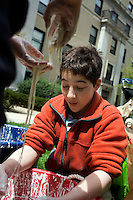 Gabe (right), 15, and Caleb Trotz, 10, of Acton, Massachusetts, play with a hands-on demonstration of non-newtonian liquid physics with corn starch and water during the MIT Under the Dome open house in Cambridge, Massachusetts, USA.