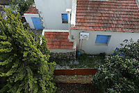 Pictured: The boundary wall by the house next door to the house owned by the Hatton couple Wednesday 15 February 2017<br /> Re: John and Heather Hatton, expat couple in Greece who are unable to sell their house in the village of Vamos, Chania, Crete to return to the UK because their neighbour won't pay his taxes.<br /> Heather Hatton needs to return to the UK for urgent medical care.