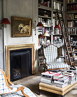 The cluttered bookcases of the library give the room a truly lived in feel, furnished with a pair of armchairs ideally placed to enjoy a book or magazine infront of a roaring fire