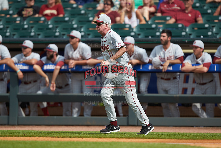 Florida State Seminoles head coach Mike Martin runs out on the field to argue a call during the game against the Louisville Cardinals in Game Eleven of the 2017 ACC Baseball Championship at Louisville Slugger Field on May 26, 2017 in Louisville, Kentucky. The Seminoles defeated the Cardinals 6-2. (Brian Westerholt/Four Seam Images)