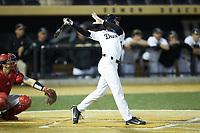 Michael Turconi (6) of the Wake Forest Demon Deacons follows through on his swing against the Sacred Heart Pioneers at David F. Couch Ballpark on February 15, 2019 in  Winston-Salem, North Carolina.  The Demon Deacons defeated the Pioneers 14-1. (Brian Westerholt/Four Seam Images)