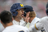 Michigan Wolverines outfielder Jordan Brewer (22) celebrates after scoring against the Texas Tech Red Raiders during the first game of the NCAA College World Series on June 15, 2019 at TD Ameritrade Park in Omaha, Nebraska. Michigan defeated Texas Tech 5-3. (Andrew Woolley/Four Seam Images)