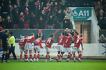 Bristol City 1 Middlesbrough 0, 16/01/2016. Ashton Gate, Championship. Bristol City players celebrate Wes Burns winning injury time goal during the game between managerless Bristol City and Championship leaders Middlesbrough. Ashton Gate is located in the south-west of the city, it currently has an all-seated capacity of 16,600, due to redevelopment, which will increase to a capacity of 27,000 by the start of the 2016-17 season. Bristol City won the game one goal to nil with a headed injury time winner. Photo by Simon Gill