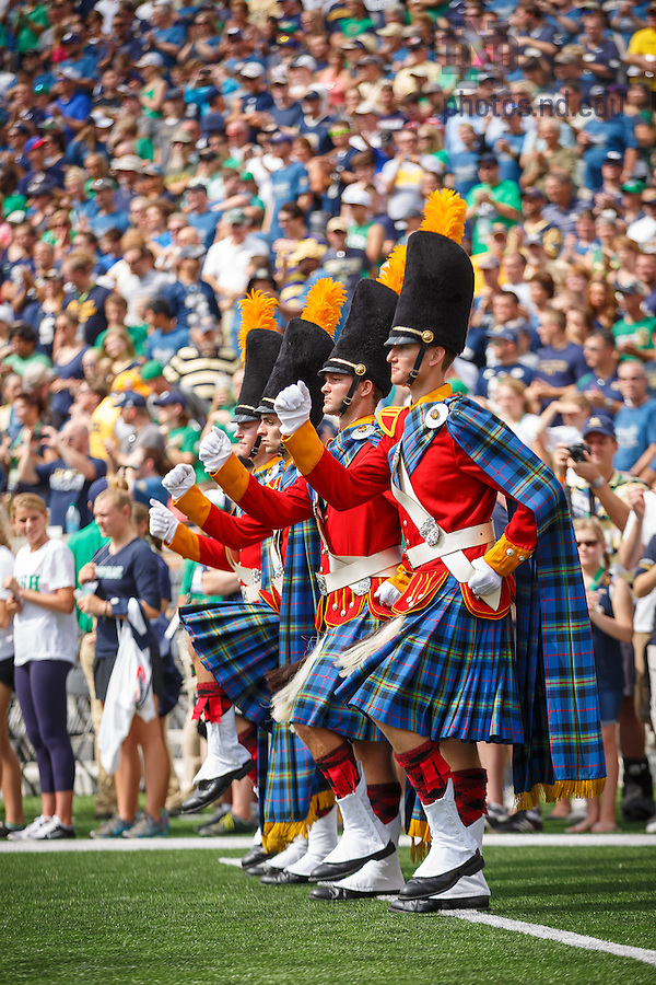 Aug. 30, 3014; The Irish Guard marches during the season opening football game against Rice..Photo by Peter Ringenberg/University of Notre Dame