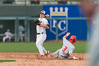 Oregon State Beavers second baseman Ryan Ober (18) attempts to turn a double play during a game against the New Mexico Lobos on February 15, 2019 at Surprise Stadium in Surprise, Arizona. Oregon State defeated New Mexico 6-5. (Zachary Lucy/Four Seam Images)