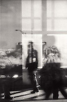 Shadows of people through window<br />