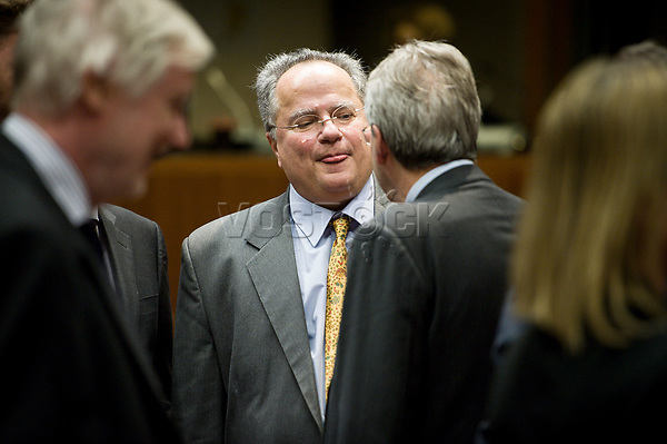 Greek Foreign Minister Nikos Kotzias shows a tongue  prior to the European Union Foreign Ministers Council at EU headquarters  in Brussels, Belgium on 29.01.2015 Federica Mogherini , EU High representative for foreign policy called extraordinary meeting on the situation in Ukraine after the attack on Marioupol.  by Wiktor Dabkowski