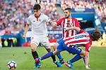 Carlos Joaquin Correa (l) of Sevilla FC competes for the ball with Filipe Luis and Jorge Resurreccion Merodio, Koke, of Atletico de Madrid during their La Liga match between Atletico de Madrid and Sevilla FC at the Estadio Vicente Calderon on 19 March 2017 in Madrid, Spain. Photo by Diego Gonzalez Souto / Power Sport Images