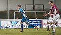 Queen of the South's Nicky Clark starts his celebrations after he scores their late equaliser as Arbroath's Alex Keddie looks on in disbelief.