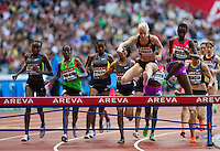 06 JUL 2012 - PARIS, FRA - Barbara Parker of Great Britain (second from right in black) clears a hurdle during the women's 3000m Steeplechase at the 2012 Meeting Areva athletics meet held in the Stade de France in Paris, France (PHOTO (C) 2012 NIGEL FARROW)