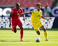 CLEVELAND, OH - JUNE 22: Terence Vancooten #15 avoids Abdiel Arroyo #18 as he attacks during a game between Panama and Guyana at FirstEnergy Stadium on June 22, 2019 in Cleveland, Ohio.