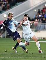 Maryland's Jason Garey (9) and SMU's Jay Needham (14). The University of Maryland Terrapins defeated the Southern Methodist University Mustangs 4-1 in a Men's College Cup Semifinal at SAS Stadium in Cary, NC, Friday, December 9, 2005.