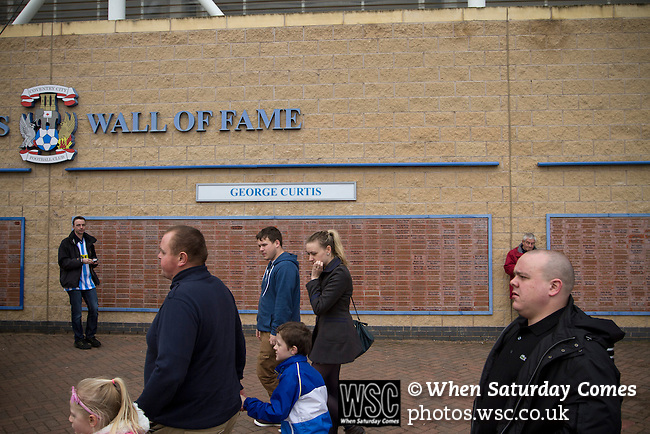 Coventry City 1 Birmingham City 1, 10/03/2012. Ricoh Arena, Championship. Home fans passing a 'Wall of Fame' dedicated to former home player George Curtis outside the Ricoh Arena, pictured before Coventry City hosted Birmingham City in an Npower Championship fixture. The match ended in a one-all draw, watched by a crowd of 22,240. The Championship was the division below the top level of English football. Photo by Colin McPherson.