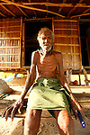 Local elderly man in a fishermen village at.Panasia Island.Panasia is a spectacular island of uplifted coral reef making jagged limestone cliffs in the Louisiade Archipelago..The Louisiade Archipelago is a string of ten larger volcanic islands frequently fringed by coral reefs, and 90 smaller coral islands located 200 km southeast of New Guinea, stretching over more than 160 km and spread over an ocean area of 26,000 km  between the Solomon Sea to the north and the Coral Sea to the south. The aggregate land area of the islands is about 1,790 kmu178  (690 square miles), with Vanatinai (formerly Sudest or Tagula as named by European claimants on Western maps) being the largest..Sideia Island and Basilaki Island lie closest to New Guinea, while Misima, Vanatinai, and Rossel islands lie further east..The archipelago is divided into the Local Level Government (LLG) areas Louisiade Rural (western part, with Misima), and Yaleyamba (western part, with Rossell and Tagula islands. The LLG areas are part of Samarai-Murua District district of Milne Bay. The seat of the Louisiade Rural LLG is Bwagaoia on Misima Island, the population center of the archipelago. .The Louisiade Archipalego is part of the Milne Bay province of Papua New Guinea..It lies between approximately 10 degrees south and 11.5 degrees south, and 151 degrees east and 154 degrees east. It is an area of Islands, reefs and cays some 200 nm long and 50 nm wide, stretching from the south east tip of mainland Papua New Guinea in a east south east direction..Panasia Island.Panasia is a spectacular island of uplifted coral reef making jagged limestone cliffs in the the Louisiade Archipelago..The Louisiade Archipelago is a string of ten larger volcanic islands frequently fringed by coral reefs, and 90 smaller coral islands located 200 km southeast of New Guinea, stretching over more than 160 km and spread over an ocean area of 26,000 km  between the Solomon Sea to the north and the Coral Sea to the south. The aggregate