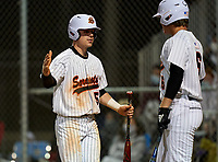 Sarasota Sailors Caden Marsters (5) celebrates with Carter Hilton (6) after scoring a run during a game against the Riverview Rams on February 19, 2021 at Rams Baseball Complex in Sarasota, Florida. (Mike Janes/Four Seam Images)